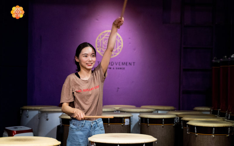Nanta Drum Experience raising hand