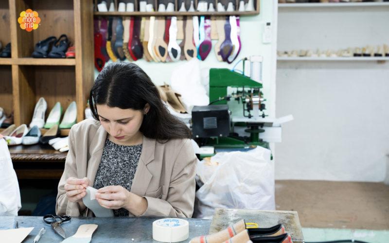 girl in shoe making class