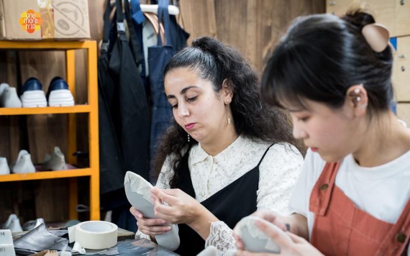 girls making shoes